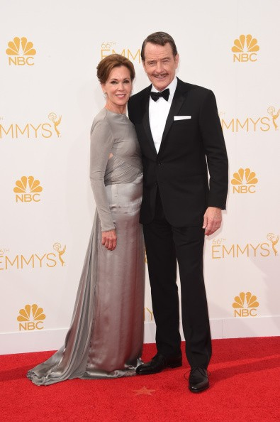 Actor Bryan Cranston (R) and Robin Dearden attend the 66th Annual Primetime Emmy Awards held at Nokia Theatre L.A. Live on August 25, 2014 in Los Angeles, California.