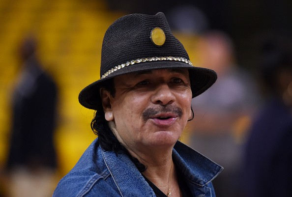 Caption:OAKLAND, CA - JUNE 07: Musician Carlos Santana rehearses prior to Game Two of the 2015 NBA Finals between the Golden State Warriors and the Cleveland Cavaliers at ORACLE Arena on June 7, 2015 in Oakland, California. NOTE TO USER: User expressly acknowledges and agrees that, by downloading and or using this photograph, user is consenting to the terms and conditions of Getty Images License Agreement. (Photo by Thearon W. Henderson/Getty Images)