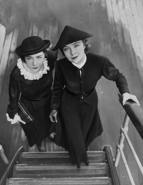 Dorothy (left) and Lillian Gish arrive in New York from a tour of the Balkan Islands.