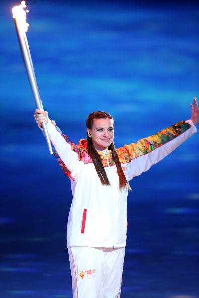Yelena Isinbayeva of Russia carries the Olympic Torch during the Opening Ceremony of the 2014 Winter Olympic Games at the Fisht Olympic Stadium on February 7, 2014 in Sochi, Russia.