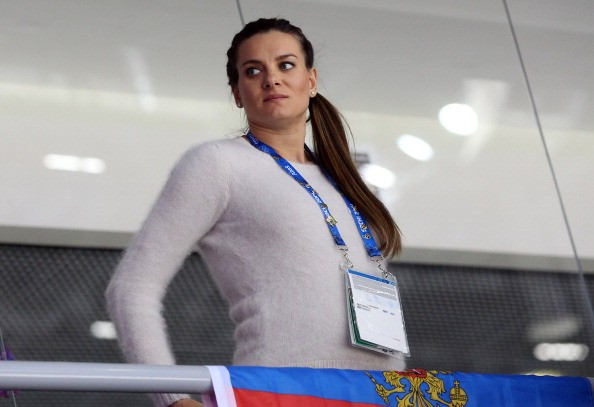 Pregnant Yelena Isinbayeva of Russia attends the Men's Ice Hockey Qualification Playoff game between Norway and Russia on day eleven of the Sochi 2014 Winter Olympics at Bolshoy Ice Dome on February 18, 2014 in Sochi, Russia.