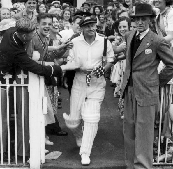 Retired Australian captain Don Bradman makes his way onto the MCG in 1948 for his testimonial match in Melbourne, Australia.
