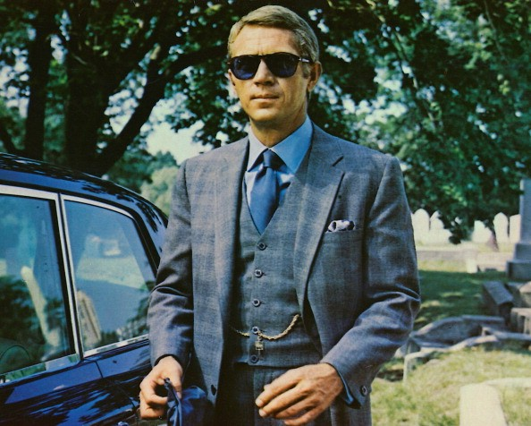 Steve McQueen (1930-1980), US actor, wearing sunglasses with a grey suit, a blue shirt and dark blue tie in a publicity image issued for the film, 'The Thomas Crown Affair', USA, 1968. The crime drama, directed by Norman Jewison, starred McQueen as 'Thomas Crown'.