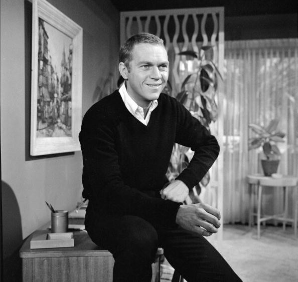 American actor Steve McQueen (1930 - 1980) smiles during the filming of an episode of the television anthology series 'Alfred Hitchcock Presents' entitled 'Man from the South,' December 23, 1959. The episode, which also featured McQeen's wife Philippine Neile Adams, was directed by Norman Lloyd and was originally broadcast on January 3, 1960. (Photo by )