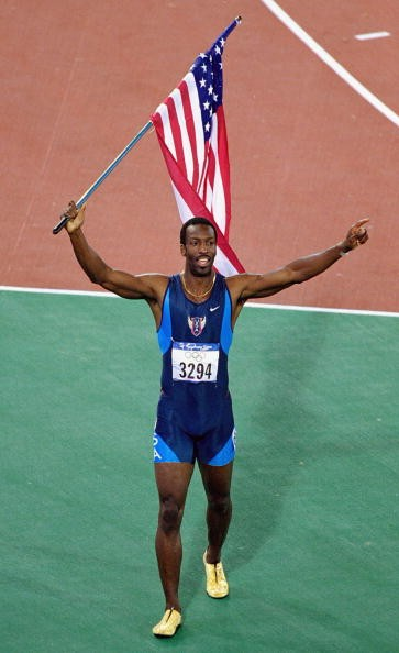 Michael Johnson of the USA celebrates gold in the Mens 400m Final at the Olympic Stadium on Day Ten of the Sydney 2000 Olympic Games in Sydney, Australia.