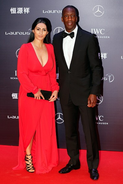 Retired American sprinter Michael Johnson poses with his wife on the red carpet for Laureus World Sports Awards ceremony at the Grand Theater on April 15, 2015 in Shanghai, China.