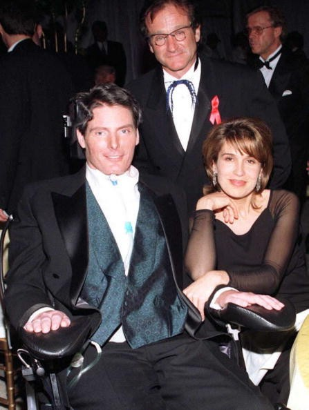 Actor Christopher Reeve (L), wife Dana (R) and comedian-actor Robin Williams (C) pose while at the Governor's Ball after the 68th Annual Academy Awards 25 March in Los Angeles. Reeve made his first appearance before the Hollywood community after an equestrian accident left him paralyzed a year ago.