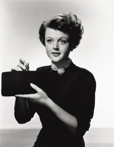British-born American actress Angela Lansbury posing for a perfume commercial. 1940s