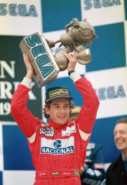 Brazilian racing driver Ayrton Senna (1960 - 1994) with the trophy after winning the European Grand Prix at Donnington Park in a McLaren-Cosworth, 11th April 1993.