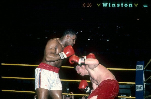 Mike Tyson (L) lands a punch against Steve Zouski during the fight at Nassau Coliseum in Uniondale, New York. Mike Tyson won by a KO 3.
