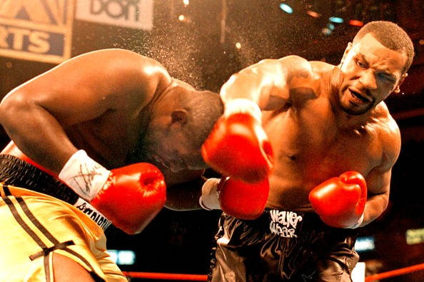 Boxer Mike Tyson lands a right on the head of Buster Mathis Jr. during a fight in Philadelphia, 16th December 1995.