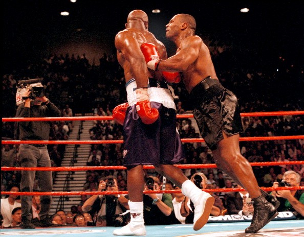 American boxer Mike Tyson bites Evander Holyfield's right ear during a fight at the MGM Grand Hotel and Casino, Las Vegas, 28th June 1997.