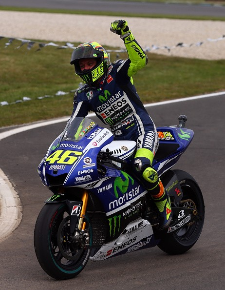 Valentino Rossi of Italy and rider of the #46 Movistar Yamaha MotoGp Yamaha celebrates after winning the 2014 MotoGP of Australia at Phillip Island Grand Prix Circuit on October 19, 2014 in Phillip Island, Australia.