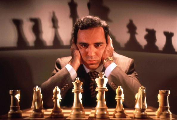 Chess champion Gary Kasparov contemplating board, training for his May rematch w. smarter version of Deep Blue, IBM computer that spooked him last yr.