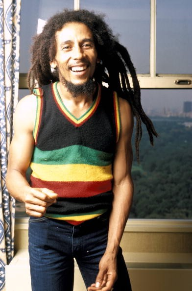 Photo of Bob MARLEY; Posed portrait of Bob Marley. The photograph was taken in his hotel room at the St Moritz Hotel on September 21, 1980.