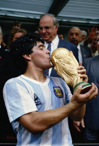 Diego Maradona of Argentina kisses the trophy after the World Cup final against West Germany at the Azteca Stadium in Mexico City. Argentina won the match 3-2.