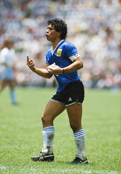 Diego Maradona of Argentina reacts whilst carrying a water bag during the FIFA 1986 World Cup match between Argentina and England at the Azteca Stadium in Mexico City, Mexico on June 22, 1986