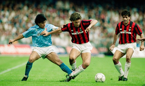 Napoli player Diego Maradona (l) challenges Carlo Ancelotti of AC Milan during an Italian League match on October 21, 1990 in Naples, Italy.