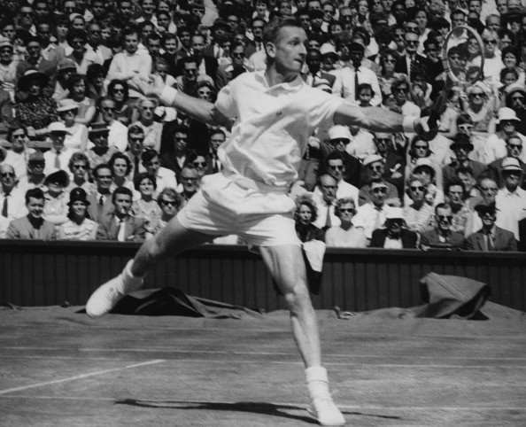 Australian tennis player Rod Laver during the Men's Singles semi-final against Ramanathan Krishnan of India on the Centre Court at Wimbledon, 5th July 1961. Laver won the match 6-2, 8-6, 6-2 and went on to win the final against Chuck McKinley.