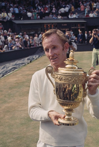 Rod Laver of Australia stands holding the Gentlemen's singles trophy after winning the Men's Singles final against his fellow countryman Tony Roche in straight sets at the 1968 Wimbledon Championships in Wimbledon, London on 6th July 1968.
