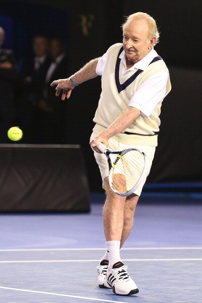 Australian tennis legend Rod Laver hits a forehand when hitting with Roger Federer of Switzerland during the Roger Federer Charity Match at Melbourne Park on January 8, 2014 in Melbourne, Australia. (Photo by )