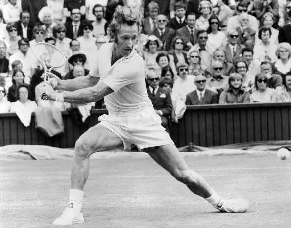Australian tennis player Rod Laver stretches to reach a ball against Tom Okker, 27 June 1971, during the Wimbledon championships. Laver won four times the men's singles title at Wimbledon in 1961, 1962, 1968, and 1969. Throughout his career, he won twice the Grand Slam (Wimbledon, Melbourne, Roland Garros, Forest Hills), in 1962 and 1969.