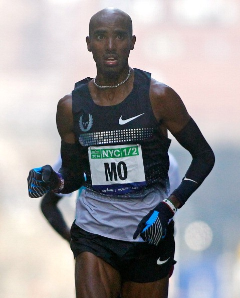 Mo Farah of Great Britain finishes in second place at the 2014 New York City Half Marathon in lower Manhattan on March. 16, 2014 in New York City. Farah collapsed at the finish line after tumbling during the race.