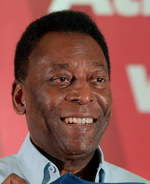 Former Brazilian footballer Pele holds a team jersy of Atletico-de-Kolkata the city based franchise of ongoing Indian Super League (ISL) football during a press conference Kolkata on October 12, 2015. Pele is on a three-day visit to the city.