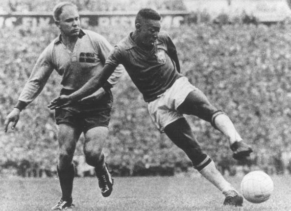 1958 World Cup Final, Stockholm, Sweden, 29th June, 1958, Sweden 2 v Brazil 5, Brazil's Pele shoots as he is challenged by a Swedish defender