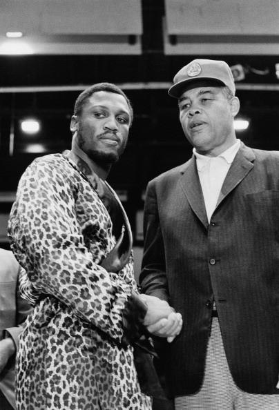 American boxing champion Joe Frazier (left), 4th March 1971.