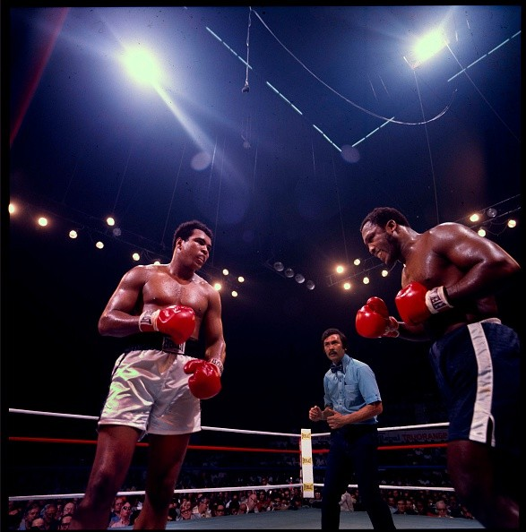 American boxers Muhammad Ali (born Cassius Clay) (left) and Joe Frazier (1944 - 2011) face off in the ring at Araneta Coliseum, Quezon City, Philippines, October 1, 1975. Referee Carlos Padilla is visible in center. The bout, billed as 'the Thrilla in Manila,' was the third time the men had fought and this time, Ali emerged victorious.