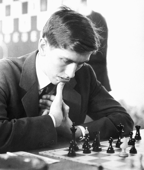 This photo of Bobby Fischer was taken during a chess match in Warsaw, Poland. His opponent representing the host country is B. Sliwa.