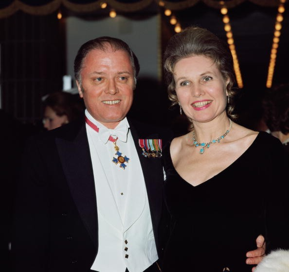 English film director Sir Richard Attenborough and his wife, actress Sheila Sim, arrive at the Odeon Leicester Square for the premiere of 'Anne of the Thousand Days', 23rd February 1970. Attenborough is wearing his CBE (Commander of the Order of the British Empire).
