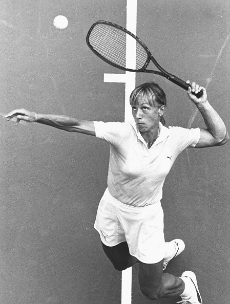 Czech born American tennis player Martina Navratilova reaches up to serve during a match at the US Open Tennis Championships at Flushing Meadow, New York in 1983.
