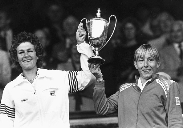 Women's Doubles tennis players Pam Shriver (left) and Martina Navratilova hold their trophy in the air after winning the Doubles at Wimbledon Tennis Championships, London, 1982.