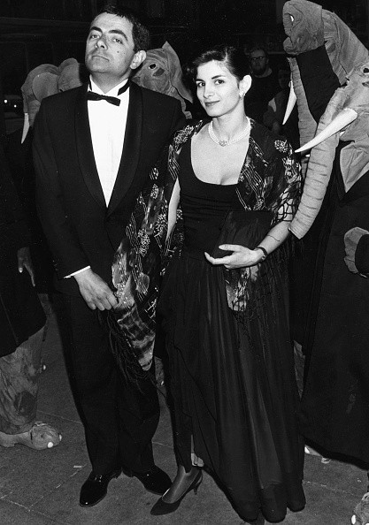 British actor Rowan Atkinson and his partner Sunetra Sastry, at the premiere of the film 'The Tall Guy', 1989.