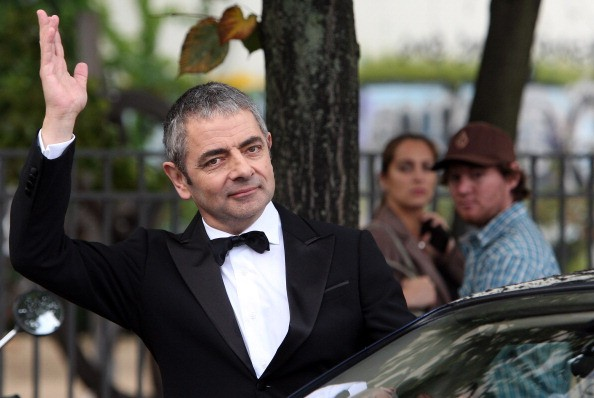 British Actor Rowan Atkinson waves on September 27, 2011 in Berlin, Germany. Atkinson was in Berlin to promote the German release of his James Bond parody's sequel, 'Johnny English - Jetzt Erst Recht' ('Johnny English Reborn'), in cinemas in the country from October 6.