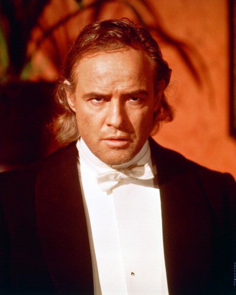 Marlon Brando (1924-2004), US actor, wearing a black jacket, white shirt and white bow tie, with a menacing look on his face, in a publicity portrait issued for the film, 'The Nightcomers', 1971. The horror film, a prequel to Henry James' 'The Turn of the Screw', directed by Michael Winner, starred Brando as 'Peter Quint'.