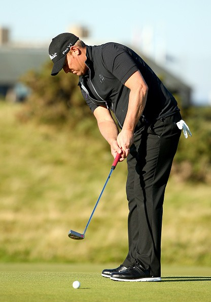 Shane Warne on the 17th green during the first round of the 2015 Alfred Dunhill Links Championship at The Old Course on October 1, 2015 in St Andrews, Scotland.