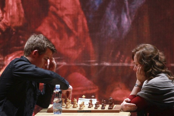 Magnus Carlsen from Norway and Judit Polgar from Hungary play the final chess game Foursquare Blindfold and Rapid Tournament, as part of the Second Great International Chess Festival UNAM 2012 at the Sala Nezahualcoyotl on November 25, 2012, in Mexico City, Mexico. (Photo by )