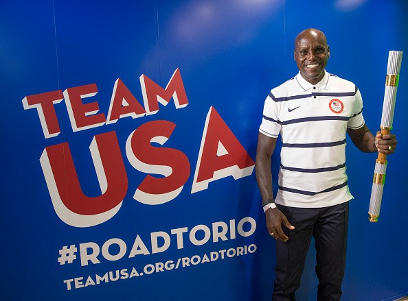 Olympic medalist Carl Lewis poses for a picture during the Team USA Road to Rio Tour presented by Liberty Mutual Insurance on July 4, 2015 at the Benjamin Franklin Parkway in Philadelphia, Pennsylvania.
