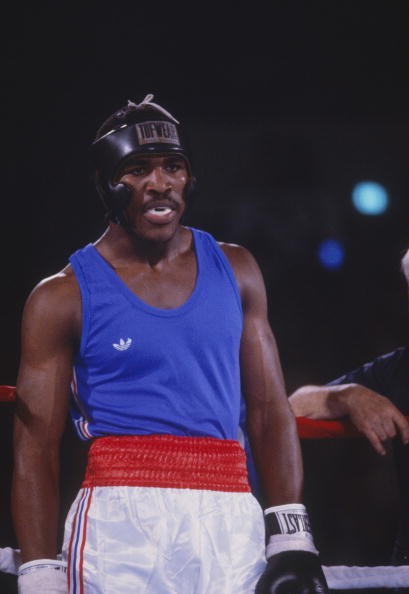 Team USA's Evander Holyfield walks in the rink during an amateur boxing match.