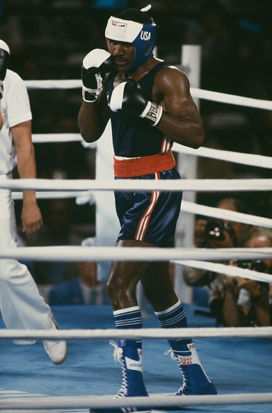Evander Holyfield of the USA in the ring during the semi-final of the Light Heavyweight boxing event at the Los Angeles Memorial Sports Arena during the 1984 Summer Olympics, 9th August 1984. The match ended in controversy after referee Gligorije Novicic of Yugoslavia disqualified Holyfield for hitting after the break.