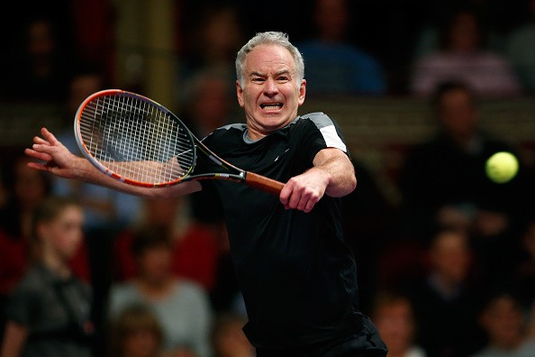 John McEnroe of the USA plays a backhand during his Tie Break Tens singles match against Tim Henman of Great Britain during day four of the Statoil Masters Tennis at the Royal Albert Hall on December 5, 2015 in London, England.