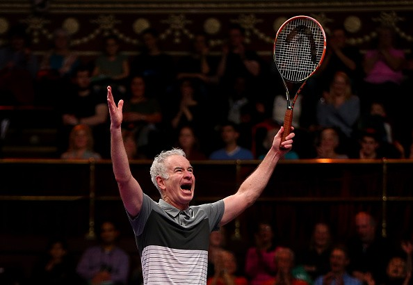 John McEnroe of the USA celebrates victory in his Legends Exhibition singles match against Henri Leconte of France during day five of the Statoil Masters Tennis at the Royal Albert Hall on December 6, 2015 in London, England.