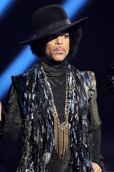 Prince presents the award for British Female Solo Artist at The BRIT Awards 2014 at 02 Arena on February 19, 2014 in London, England.