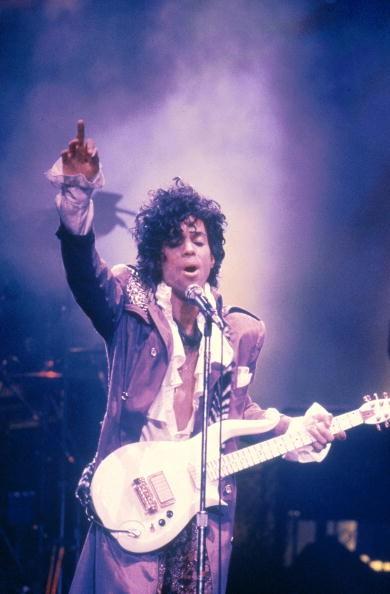 Prince performing on stage - Purple Rain Tour