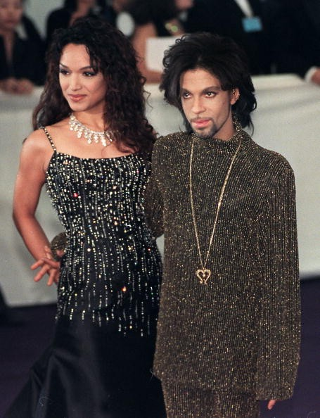 Prince poses for photographers with his wife Mayte as they arrives at the De Beer and Versace 'Diamonds are forever' charity fashion event 09 June 1999. A host of international celebrities turned out for the event which will raise funds for three charities including the Prince's Foundation for architecture and the environment.