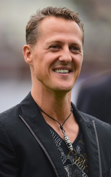Formula 1 legend Michael Schumacher looks on during the day of the legends event at the Millentor stadium on September 8, 2013 in Hamburg, Germany.
