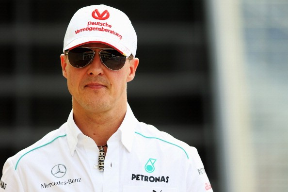 Michael Schumacher of Germany and Mercedes GP walks in the paddock following practice for the Brazilian Formula One Grand Prix at the Autodromo Jose Carlos Pace on November 23, 2012 in Sao Paulo, Brazil.